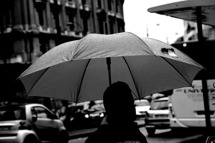 Man with umbrella in rain