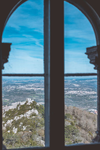 The colourful Pena Palace of Sintra, Portual. Water Window Sea Sky Day Horizon Architecture Indoors  Nature No People Transparent Scenics - Nature Horizon Over Water Land Beauty In Nature Beach Glass - Material Built Structure Architectural Column Castle Moorish Architecture Palace