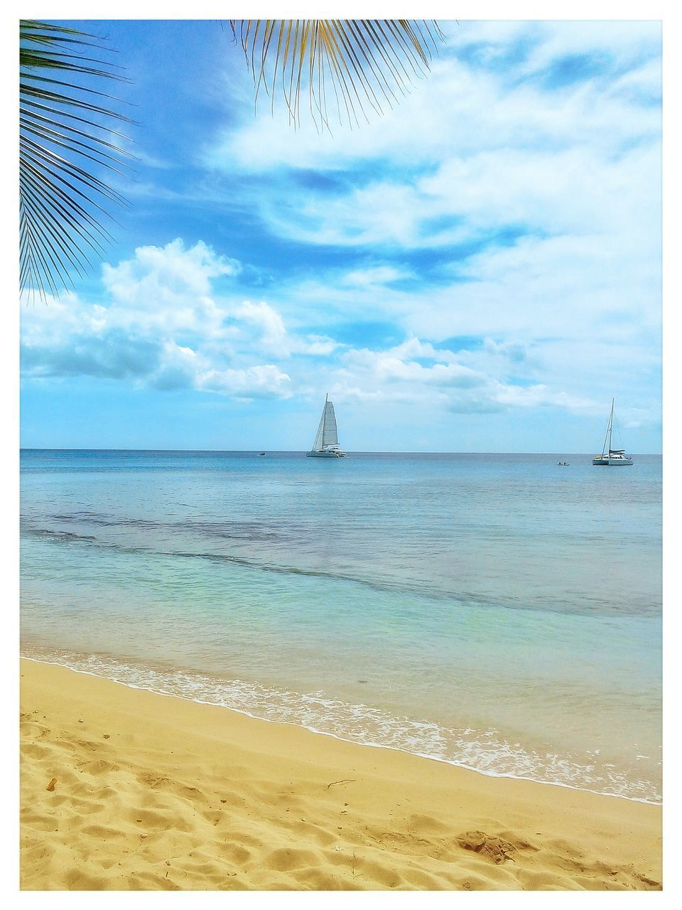 sea, horizon over water, beach, sky, sand, water, shore, beauty in nature, sailboat, day, scenics, outdoors, nature, tranquility, tranquil scene, cloud - sky, no people, nautical vessel, vacations, travel destinations, lighthouse, wave