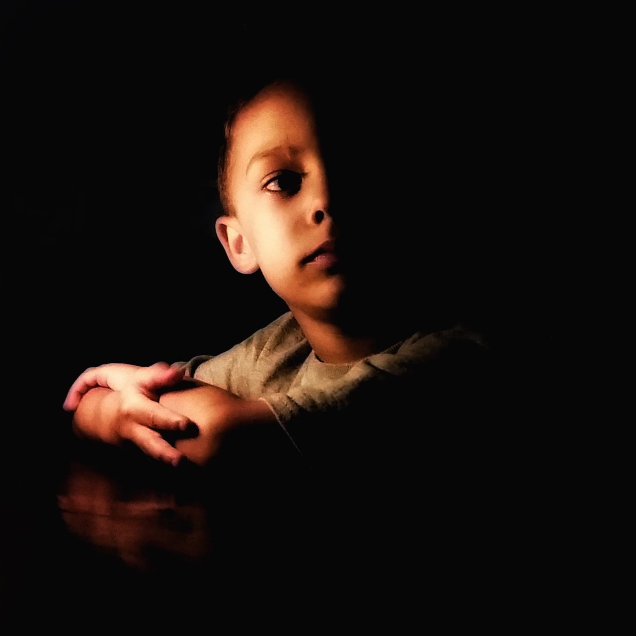 studio shot, black background, one person, portrait, indoors, childhood, child, looking at camera, copy space, headshot, cut out, dark, lifestyles, domestic room, boys, darkroom, innocence, looking, contemplation, teenager