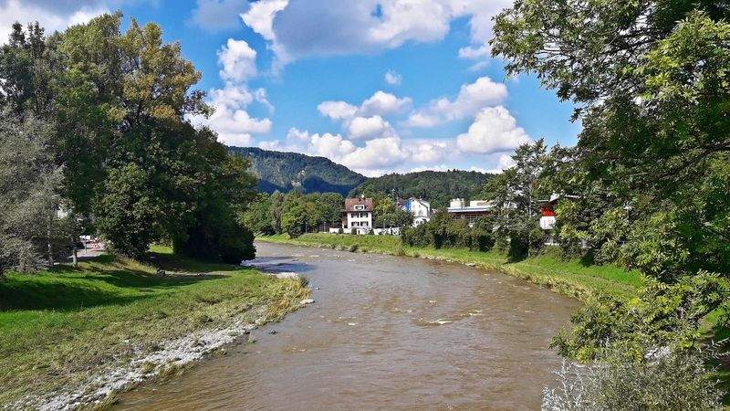 """River """"Sihl"""" in Adliswil Adliswil Beauty In Nature Cloud - Sky Day Grass Landscape Nature Outdoors River Scenics Sky Tree Water"""