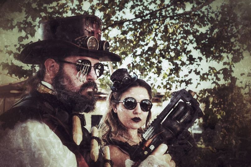 Steampunk cosplay couple during Lucca Comics&Games 2016 Steampunk Cosplay Lucca Luccacomics&games Grunge Fantasy Technology Vintage Victorian Age Retro Futuristic 19th Century Victorian Comics&games Steam Mask Science X100t Cyberpunk