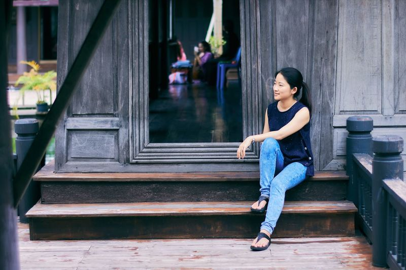 EyeEm Selects Sitting Steps One Person People Building Exterior Young Women Outdoors Relaxing Architecture Portrait Art And Craft Thailand Asian  Traditional Culture Travel Destinations Leisure Activity Wood - Material Happiness Smiling Cheerful Lifestyles Pretty Girl Fashion Model The Week On EyeEm