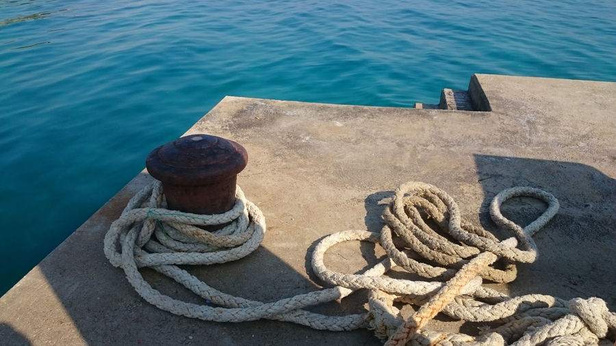 High angle view of rope on shore