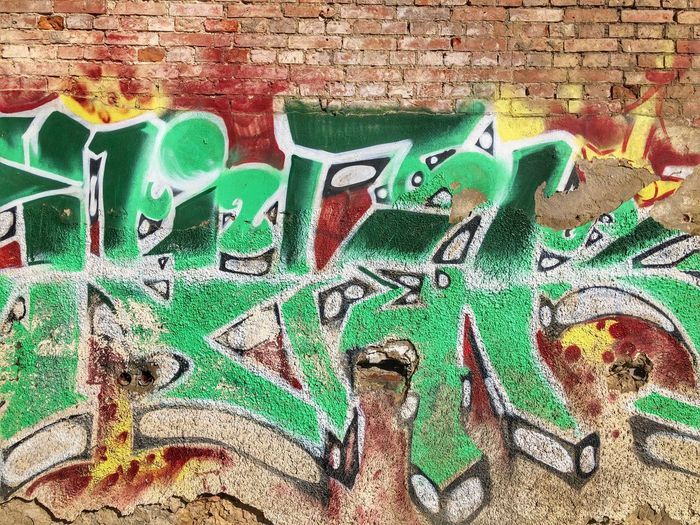 Wall - Building Feature Brick Wall Wall Multi Colored Green Color Graffiti Art And Craft Creativity Brick No People Built Structure Close-up Architecture Day Full Frame Representation Street Art Pattern Large Group Of Objects Messy Mural Turquoise Colored