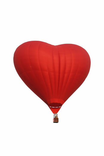 Hot air balloon flying over white background