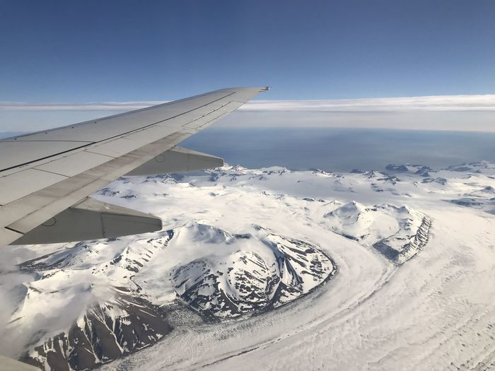 Air Vehicle Aircraft Wing Airplane Beauty In Nature Cold Temperature Day Environment Landscape Mountain Mountain Peak Mountain Range Nature No People Scenics - Nature Sky Snow Snowcapped Mountain Tranquil Scene Transportation Winter
