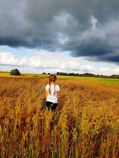 Agriculture Cloud - Sky Crop  Field Cereal Plant Rural Scene One Person Sky Growth People Day Outdoors Storm Cloud Nature Standing Landscape Girl In Crop Field Mix Yourself A Good Time Lost In The Landscape Perspectives On Nature Rethink Things Be. Ready.