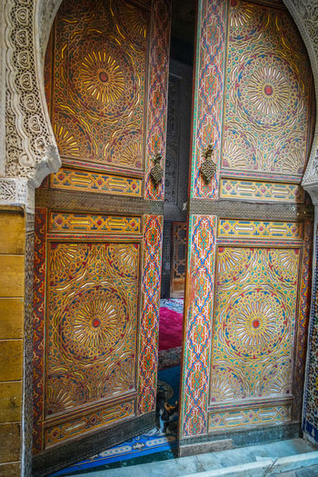 Mosque Fes Morocco Travel Destinations Travel Photography EyeEmNewHere Travelling Digital Nomad Architecture Pattern No People Indoors  Built Structure Art And Craft Design Ornate Door Craft Building Entrance Creativity Floral Pattern Multi Colored Day History The Past Wall - Building Feature Wood - Material