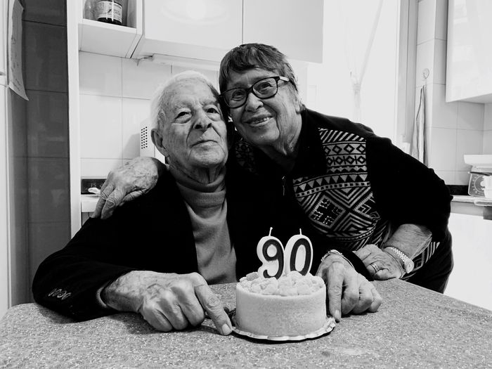 Smiling Senior Couple Celebrating Birthday At Home