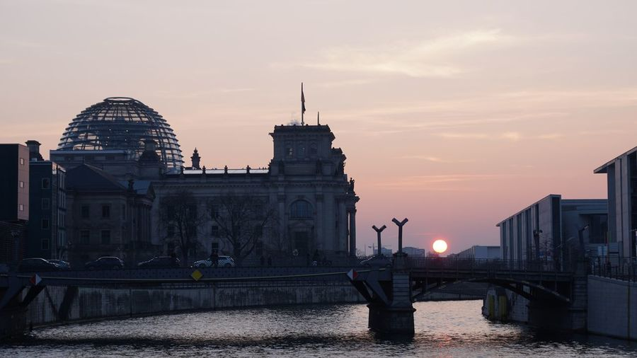 Reichstag building against sky during sunset