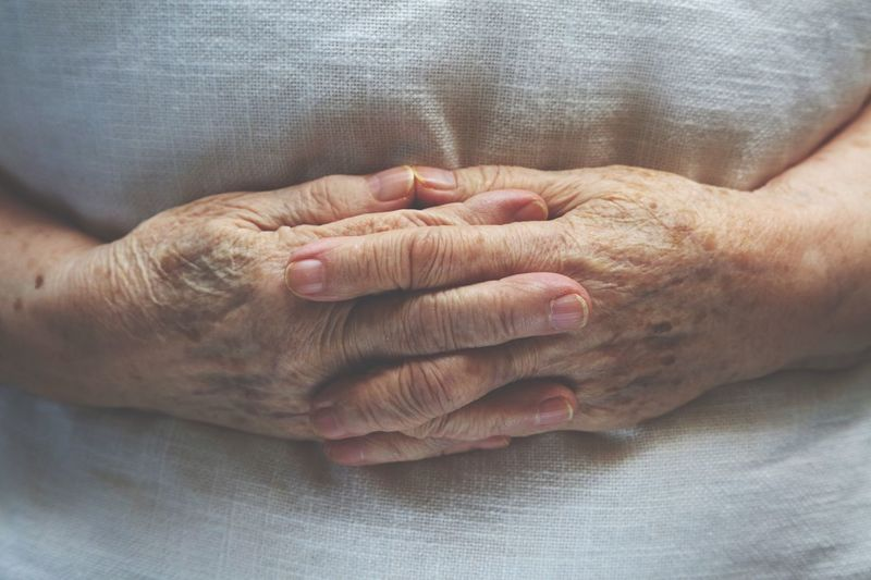 Hands of an old woman in bed Senior Adult Human Body Part Human Hand Wrinkled Two People Senior Women Togetherness Senior Men Indoors  Human Skin Real People Close-up Healthcare And Medicine Men Bonding Retirement Women Senior Couple Home Caregiver Day Hospital