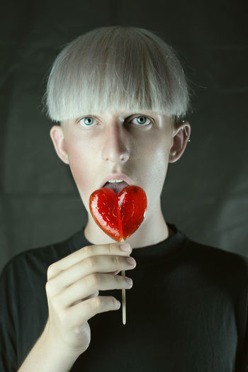 Portrait One Person Looking At Camera Front View Red Headshot Food And Drink Food Indoors  Hairstyle Studio Shot Fruit Freshness Bangs Candy Fashion Fashion Model Lifestyles Teenager Boy Blond Hair Blonde Love Sugar