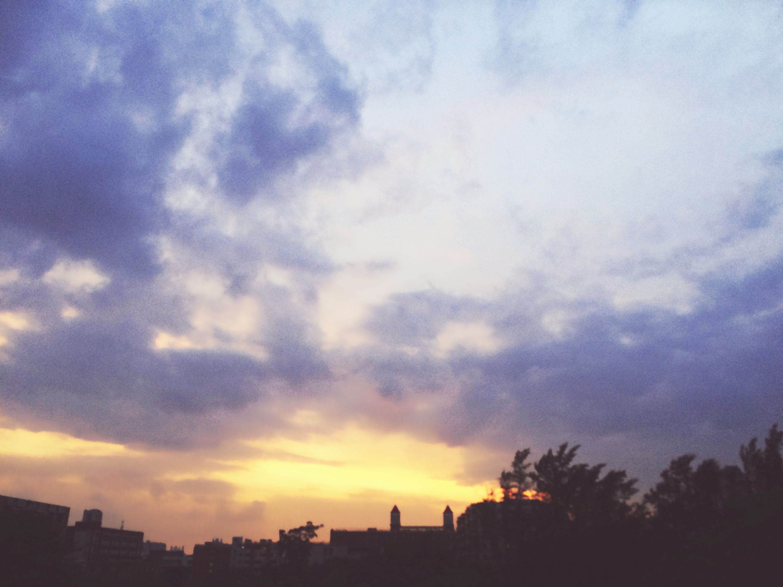 sky, sunset, silhouette, building exterior, cloud - sky, architecture, built structure, tree, cloudy, city, cloud, beauty in nature, scenics, nature, dusk, outdoors, low angle view, tranquility, tranquil scene, residential building