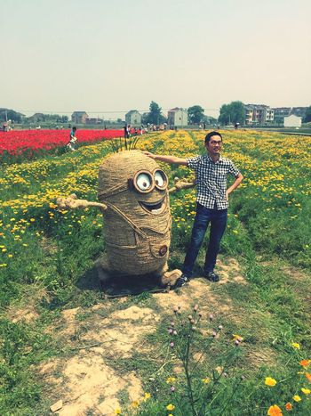 May 2015. Minions Check This Out Taking Photos Enjoying Life Flowers Field Statue Hello World Cool Funny