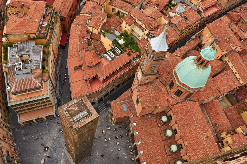 Looking down from the 97m high Asinelli Tower in Bologna Bologna Italy Looking Down Looking Down From Above Tiles Red Tiles Medieval Medieval Architecture Roof Rooftop Architecture Building Exterior High Angle View History Aerial View Urban City Historic Historical Building Church Tower Cupola Dome