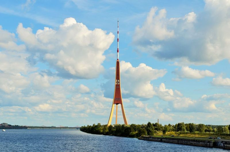 Calm lake with tower against the sky