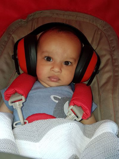 Baby Looking At Camera Babyhood Portrait Cute Real People One Person Indoors  Childhood New Life Red Babies Only Close-up Smiling Day Ear Defenders