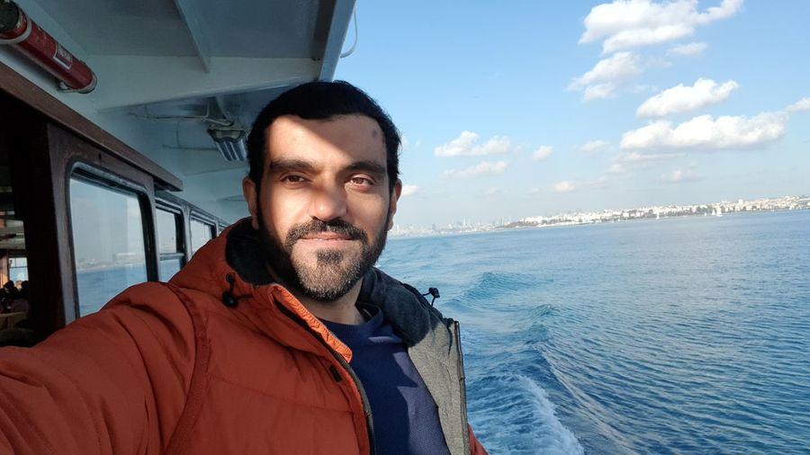 Portrait of man in sea against sky
