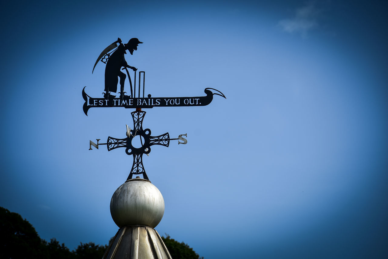 sky, blue, communication, guidance, weather vane, nature, low angle view, clear sky, text, no people, direction, sign, western script, copy space, outdoors, directional sign, arrow symbol, day, symbol, information sign