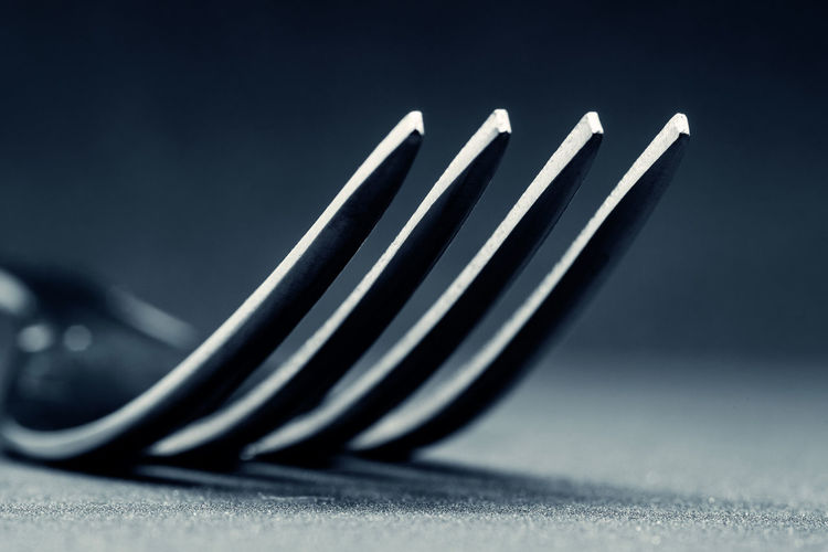 Close-up of piano keys on table