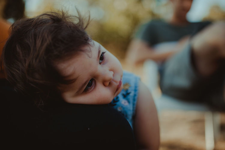 Close-up of cute baby girl looking away