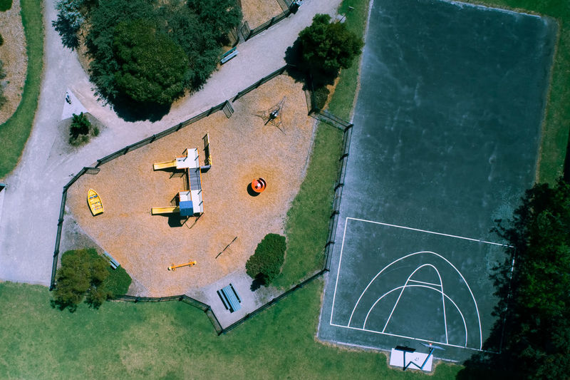 High angle view of playing field by trees in city