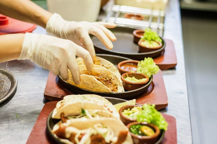 Close-up of person preparing food on table