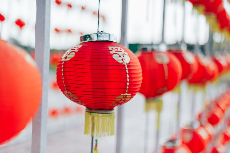 Close-up of red lanterns hanging in row
