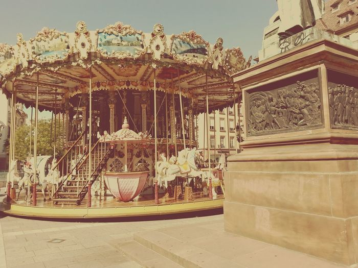 merry-go-round Arts Culture And Entertainment Outdoors Building Exterior Architecture Built Structure Amusement Park Ride Amusement Park No People City Carousel Day Sky Freedom France Strasbourg Rotation Idyllic Scenery EyeEmNewHere The Street Photographer - 2017 EyeEm Awards Live For The Story