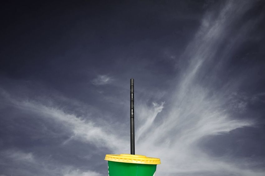 Cup Soft Drink Sky Cloud - Sky Low Angle View Nature No People Outdoors Day Sunlight High Section Street Light Environment Blue Motion Communication Beauty In Nature