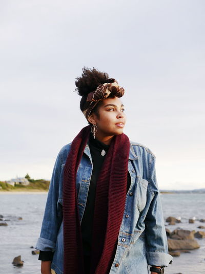 VSCO Vscocam EyeEmNewHere Nigerian Australian Tasmania Beach Water Sky Moody Dusk Sunglight Golden Hour Windy Beauty Natural Beauty Beautiful Woman Woman Female Powerful Denim Jacket Headscarf Cold Tones Phorography  Portrait Looking Away From Camera Friends Simple person
