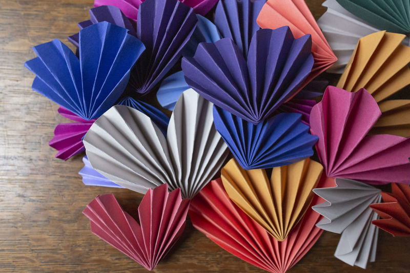 High angle view of multi colored umbrellas on table