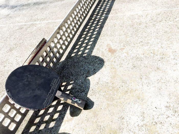 Close-up of tennis bats on ground