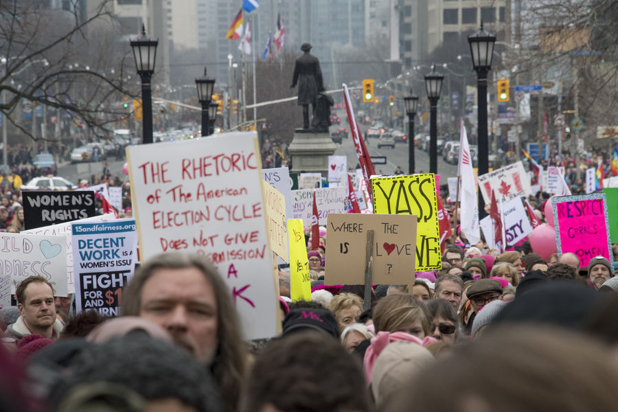 Many signs. Women's Solidarity March in Toronto, Canada. January 21, 2017 marked the history of the capital city of Ontario with one of the largest protest march gathering more than 60,000 people. Women were claiming more social justice and protesting many of Donald Trump stances. Anti-trump Canada Canadian Demanding  Democracy Freedom Girls Leftist March Movement Ontario People Power Revolution Signs Social Justice Symbols Toronto Toronto Canada Women's March Women's Solidarity March