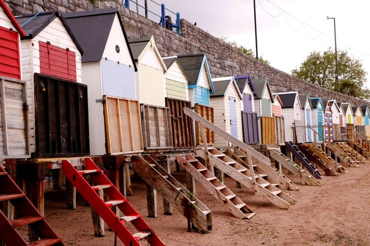 Beach huts closed up for the day at Torquay in Devon, England Steps Travel Photography Architecture Arrangement Beach Beach Huts Built Structure Coast Colorful Day Days End In A Row Locked Up No People Outdoors Seaside