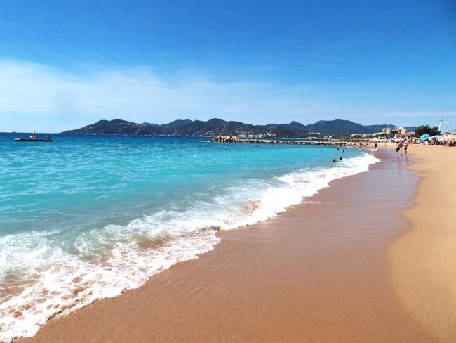 Beach Sea Sand Vacations Sunny Water Outdoors Summer Travel Destinations Blue Clear Sky Sky Nature Day Horizon Over Water Tranquility Scenics Landscape Relaxation Beauty In Nature French Riviera Cannes
