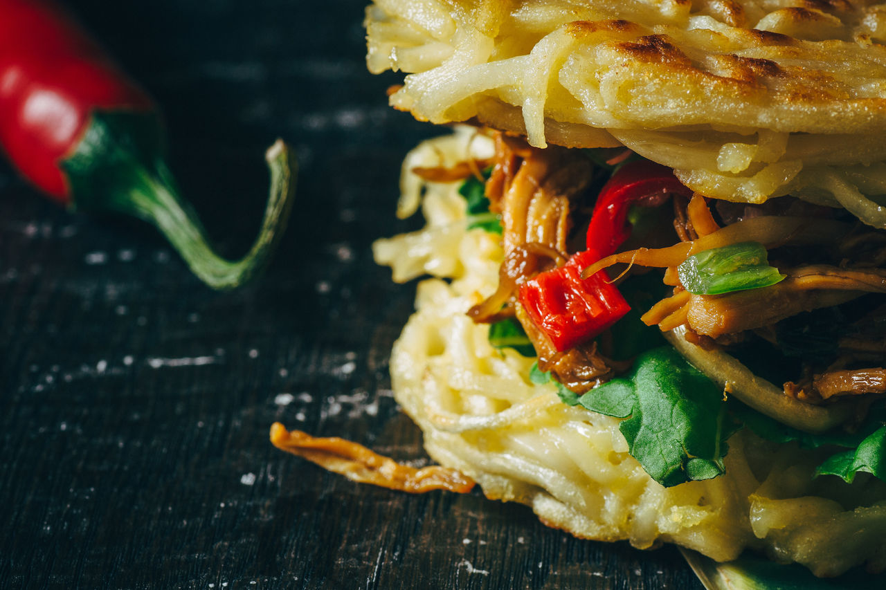 Cropped image of fresh ramen burger with red chili pepper