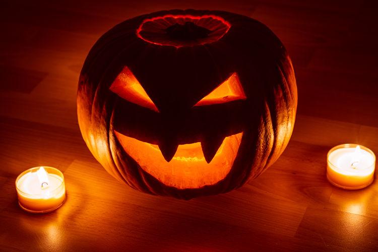 Illuminated pumpkin on table during halloween