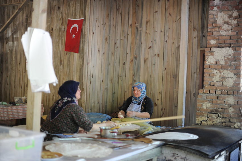 Turkish woman making lavash in traditional place Adult Adults Only Bread Culture Day Eat First Eyeem Photo Lavash Men Outdoors People Portrait Real People Restaurant Senior Adult Senior People Tradition Two People Warm Clothing Woman Working Working