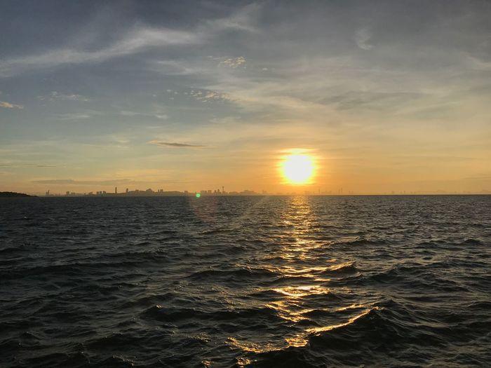 Sunset Sky Water Sea Scenics - Nature Beauty In Nature Tranquility Tranquil Scene Horizon Reflection Sun Nature Orange Color No People Non-urban Scene Sunlight Cloud - Sky Horizon Over Water Outdoors Idyllic