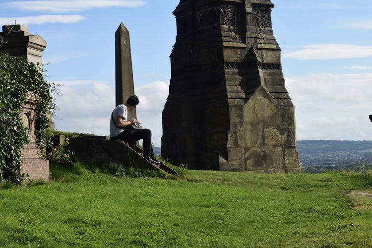 Full length of man standing on grassy field