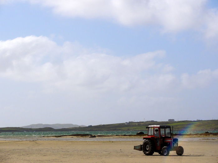 Atmosphere Beach Exploring Outdoors Rainbow Sky Summer Tractor Tractor On The Beach Traveling Vacation