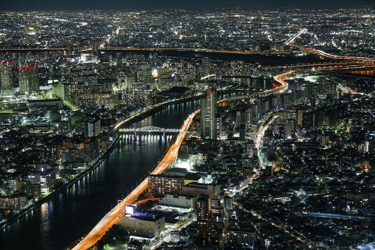 Night aerial panorama of illuminated tokyo with sumida river and bridges
