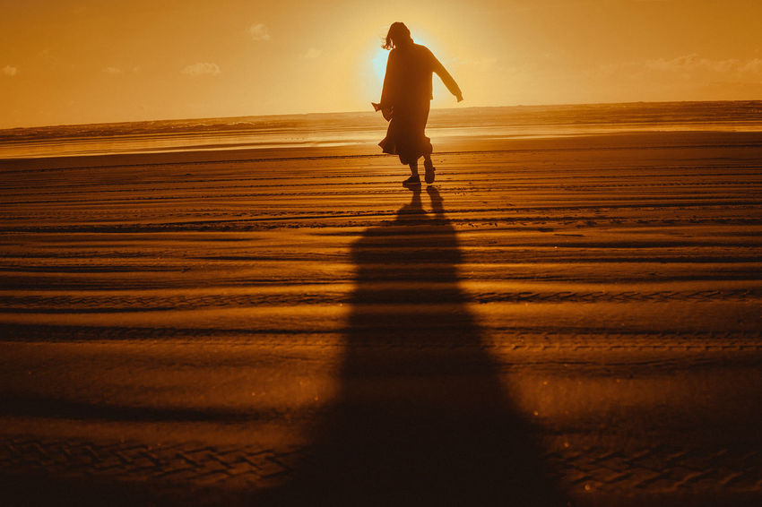 chill on the beach Beach Beauty In Nature Full Length Horizon Over Water Land Leisure Activity Lifestyles Men Nature One Person Outdoors Real People Sand Scenics - Nature Sea Shadow Silhouette Sky Sunlight Sunset Walking Water EyeEmNewHere