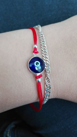 Bulgarian Blue Blue Eye Blue Red And White Colour Bracelet Bracelet Love Bracelet ♥ Bracelets Close-up Denim Fashion Fashionable Female Wrist Focus On Foreground High Angle View Individuality Part Of Person Personal Accessory Personal Perspective Red Things Wrist Wrist Bands Wrist Female Wrist Wear Youth Culture