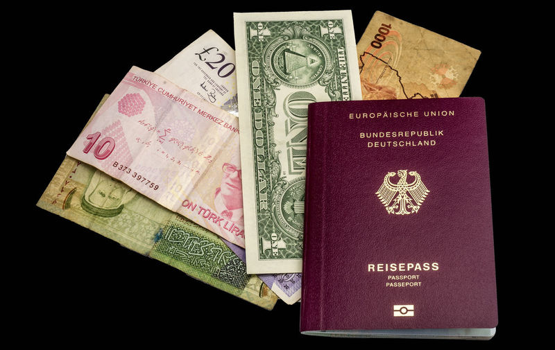 Preparing for a trip around the world with passport, banknotes from USA, Uganda, England, Turkey and Jordan, isolated against black background Trip Black Background Close-up Currency Indoors  No People Paper Currency Passport Text Wealth World