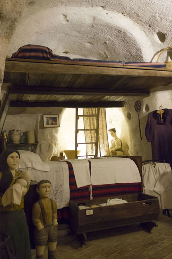 Matera Italy Unesco UNESCO World Heritage Site Grotto House Interior Ancient Cave Mode Of Transportation Transportation Group Of People Land Vehicle Men Travel People Real People Human Representation Representation Toy Indoors  Public Transportation Car Day Window Motor Vehicle Bus Vehicle Interior Group