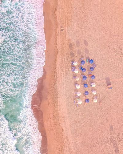 High angle view of parasols on beach