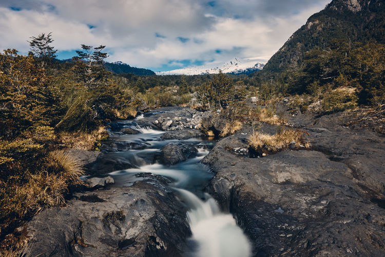 Turbio River... EyeEmNewHere Beauty In Nature Cloud - Sky Day Flowing Flowing Water Long Exposure Motion Mountain Nature No People Non-urban Scene Outdoors Plant Rock Rock - Object Scenics Scenics - Nature Sky Solid Stream - Flowing Water Tourism Travel Destinations Tree Water